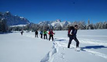 Winter hiking in the pristine nature of the Sesto Dolomites