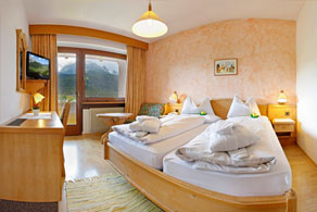 Different rooms at the Biovita Hotel Alpi Sesto / Sexten with great view to the Dolomites