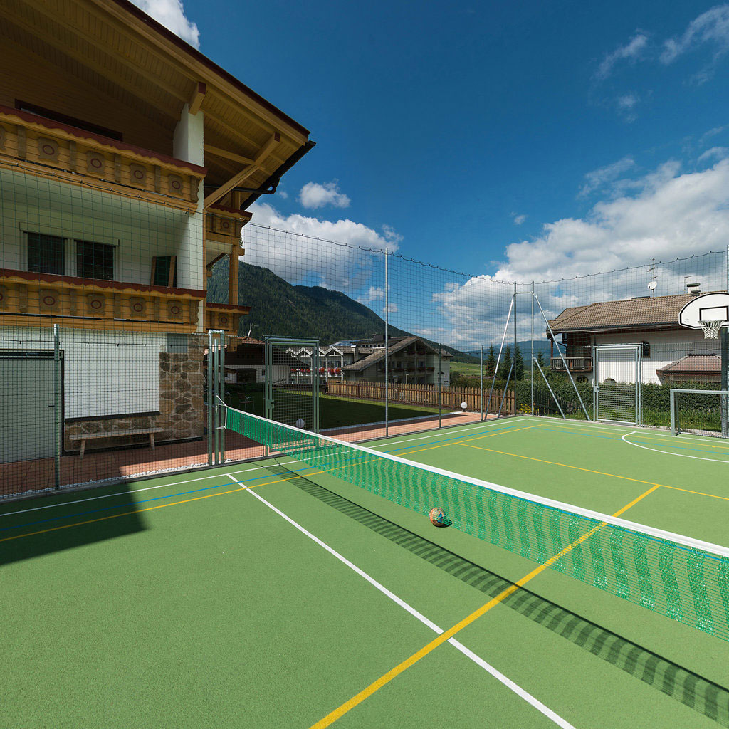 Sportsarea and tennis court at the Biovita Hotel Alpi in Sexten Sesto